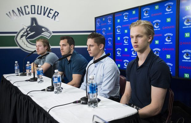 Brock Boeser, Bo Horvat, Troy Stecher, and Elias Pettersson during a press conference.